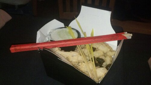 Calamari served with chopsticks
